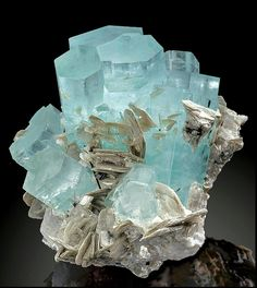 Gemmy blue Aquamarine crystals with accenting Muscovite blades on Albite, Chumar Bakhoor, Northern Pakistan