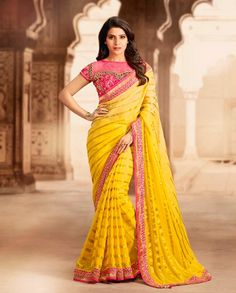 Yellow sari with heavy embellished border   1. Yellow georgette satin brocade embroidered sari2. Resham thread zari embroidered blouse3. Comes with matching unstitched blouse