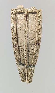 Horse frontlet with incised guilloche design, Neo-Assyrian, 8 C BC, Mesopotamia, ivory.