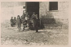 Где-то в Ростове-на-Дону. Есть много воспоминаний людей переживших первую и вторую оккупацию, как немцы фотографировали детей на улицах города.