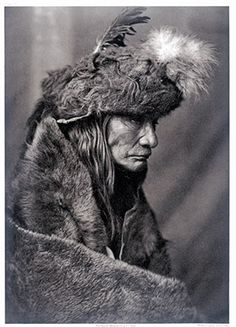Tearing Lodge, an elder of the Piegan Blackfeet, in war costume buffalo cap, 1910