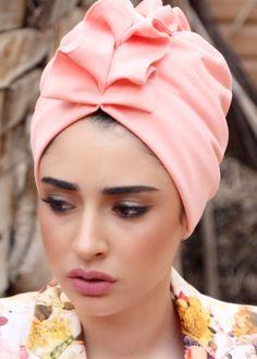 ready-to-wear Elegant fan-top turban in light Pink lycra. Great for evening-wear or special events. The turban is stretchy, light, and easy to wear! No tying involved, this turban is worn like a hat. Can be worn as a full or half head covering- tuck