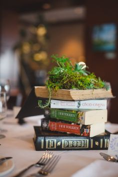 """My husband and I put our favourite books on each table along with a """"living"""" plant book. We thought this could be a way for people to """"break the ice"""" and talk about mutual books or other things as a way to introduce themselves to one another :) Inspire Others, Dyi, Succulents, Husband, Table, Books, People, Plants, Wedding"""