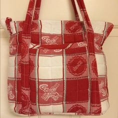 """Coca-Cola Shoulder Bag Amazing Coca-Cola quilted shoulder bag/tote.  EUC.  Double strap.  Zippered closure.  Interior has 2 large pockets and 4 small pockets. 11"""" strap drop.  Very light discoloration on bottom and 2 small spots by zipper.  Some piling.  11x3.5x12.  Awesome bag looking for a good home!  Happy to provide more picks upon request. Coca-Cola Bags"""