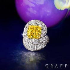Graft Diamonds. A truly stellar stone: our 5.48 carat Fancy Vivid Yellow cushion cut diamond is embraced by Fancy Vivid Yellow cushion cut diamond is embraced by beautiful round and baguette cut diamonds. #graffdiamonds #finejewelry