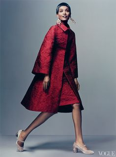 In Milan, Dolce presented an ultra-polished parade of coordinated looks for society women who know a thing or two about dressing to win. Liya Kebede wears scarlet, the most powerful hue in the spectrum. Silk-jacquard coat, dress ($3,325), floral mosaic earrings, and Mary Jane heels; select Dolce  Gabbana boutiques. Details, see In This Issue.