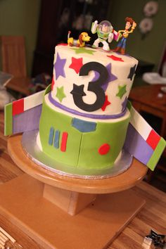 Birthday Cake Photos - Toy Story cake for a 3-year-old little boy. Chocolate cake with vanilla buttercream, fondant/gumpaste decorations, and toy toppers.