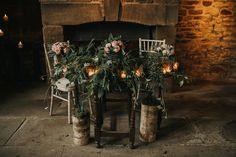 Ceremony Flowers Logs Foliage Greenery Enchanting Woodland Boho Wedding http://www.kerrydiamondphotography.com/