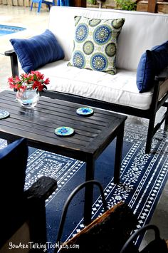 Her stenciled outdoor rug came out beautifully!! Will have to try this, and it's so much cheaper to buy just a solid colored rug, especially!