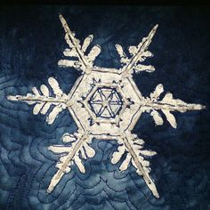 Snowflakes quilt, screen printed.  Design by Lyric Kinard, published in:  Quilting Arts magazine - Holiday 2014