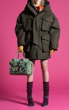 This **Dsquared2** puffer coat is rendered in virgin wool and features an oversized button placket, front patch pockets with overlying flaps, and a boxy silhouette.