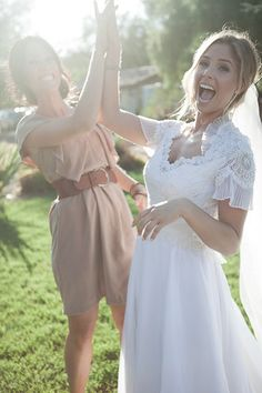 Bride and maid of honor (or groom and best man) high five.