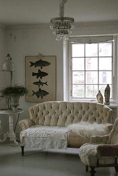 fish print ... tufted sofa ... amazing chandelier