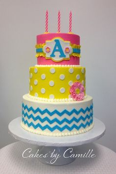 Chevron and polka dot girly birthday cake. Pink yellow blue chevron cake. monogram cake design. Cakes by Camille