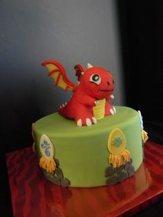 Dragonvale cake. Dragon is beyond my skill, but like the eggs on the side.