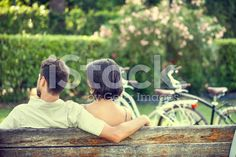 Couple in love hugging each on a bench with bikes royalty-free stock photo