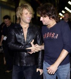 Jon Bon Jovi and Richie Sambora in 2003,about to performing.....We miss these moments!