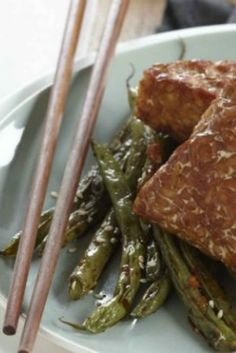 Tempeh is a fermented soy product that has a slightly bitter taste. It holds up well to strong Asian flavors and the texture is much more firm and meaty than tofu.