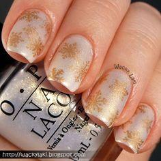 Wacky Laki: Subtle Golden Snowflakes   See more nail designs at http://www.nailsss.com/nail-styles-2014/
