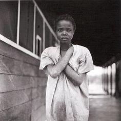 photograph Eve Arnold :    Milltown, tranquillizer drug, was tested by American drug companies at this asylum, Haiti. 1954