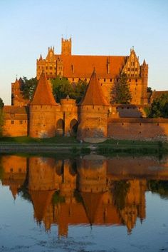 The Castle of the Teutonic Order in Malbork is the largest castle in the world by surface area, and the largest brick building in Europe. It was built in Prussia by the Teutonic Knights, a German Roman Catholic religious order of crusaders, in a form of an Ordensburg fortress. The Order named it Marienburg (Mary's Castle). The town which grew around it was also named Marienburg.