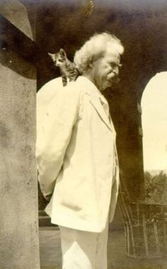"""Mark Twain and shoulder kitty.    """"Some people scorn a cat and think it not an essential; but the Clemens tribe are not of these."""""""
