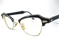 white and black layered cat eye glasses. horn rimmed by holdenism, $55.00