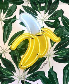 neon banana sign at Chloe's Fruit, NYC