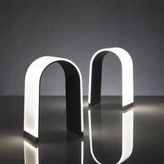 Mr. n LED Table Lamp: The light turns off and on with a simple touch of the lamp's foot, while dragging your finger across the curve of the lamp controls its dimmer.