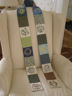 Made of calico patches, with designs (featuring the seven days of creation) stamped with acrylic paint and fabric medium, then backed with batting and muslin, quilted, and backed again with calico.