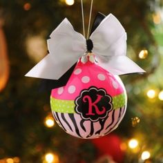 Not all ornaments have to be red and green! This adorable Pink Zebra Monogrammed ornament is the perfect gift...or just a way to personalize YOUR tree #kirklands #sneakpeek #christmas #ornaments #christmastree