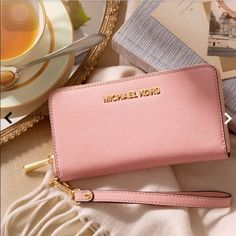 ISO!!! Michael Kors Light Pink Wallet Looking for this specific light pink Michael Kors wallet if anyone knows of someone that's selling one please tag me or lmk please thank you Michael Kors Bags Wallets