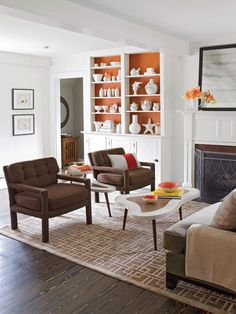 White (of course) but I love the pop of orange in the built-ins plus the tables are adorable