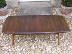 Ercol Mid Century Coffee Table With Magazine Rack by RubydoDesigns