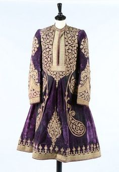 A purple velvet robe, Afghan, late 19th century. with elaborate couched gold braid arabesques and broad gold braid edgings; together with an embroidered wine velvet marriage robe, (bindali), Ottoman, late 19th century, embroidered in gold thread and sequins with swags and blossom, bust 127cm, 50in (2)