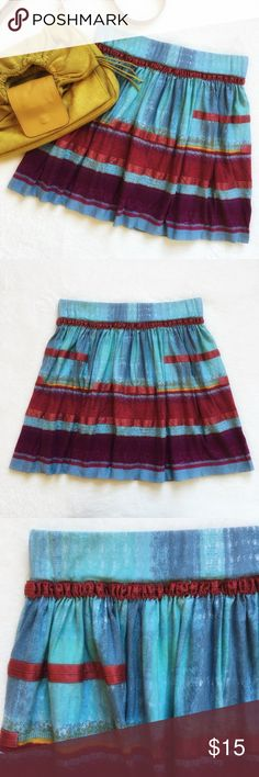 """{Ecote} Vibrant Mini Skirt Ecote from Urban Outfitters. Unique mini skirt with watercolor detail and ribbons. Super comfortable with stretch elastic waistband. Waist 14 1/2"""" flat across. 17"""" long. 94% viscose 6% spandex. Excellent preloved condition. Urban Outfitters Skirts Mini"""