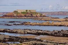 West Angle Bay to Thorn Island. At low tide / further out from the sandy beaches / a rugged sea bed is exposed.