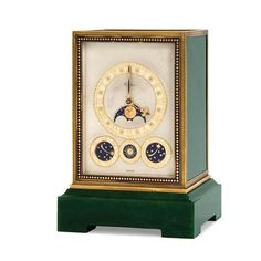 French Art Deco Eight Day Quarter Chiming Clock   Cartier, circa 1935   The spinach jade case trimmed with blue enamel and 18 kt. gold