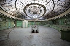 The control room of an abandoned thermal power plant in Hungary, showing the Art Deco opal glass ceiling.