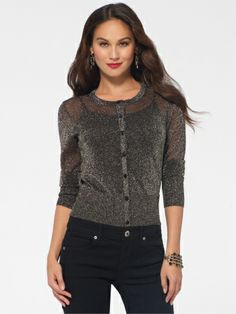 Shimmering metallic threads and a sheer fabrication jazz up a must-have essential.SheerCrew neckFront button placketLong sleeves