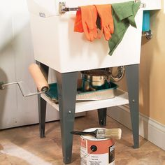 Under-Sink Shelf - Tired of moving all that stuff under the sink every time you mop the floor? Just buy a melamine closet shelf from a home center and a length of suspended-ceiling wall angle (sorry, it only comes in 10-ft. lengths, but it's cheap and you can have it cut for transport). Also pick up four 1/2-in. No. 8-24 bolts, washers and nuts. Attach it to the underside of your laundry room utility sink for a handy place to store old painting supplies and more.painting supplies