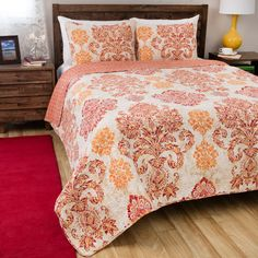 This oversized quilt set offers an Eastern pattern in bright colors on an ivory background. Crafted of 100 percent cotton, this set is comfortable and durable.