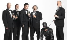 Bottoms up: Faith No More and, er, friend (left to right) Jon Hudson, Billy Gould, Mike Patton, Mike Bordin and Roddy Bottum.