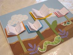 this idea could easily be made into a library display or bulletin board - spring flowers!