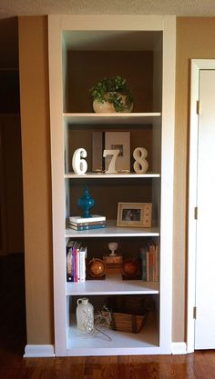 Adding interest to built in shelves with paint.