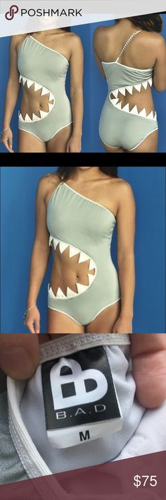 """Shark bite one piece swimsuit gray white size M Featured on ThisIsWhyImBroke.com! Funny and cute one piece/ monokini shark bite swimsuit. Fully lined, adjustable strap, with cups. """"Teeth"""" are fabric, soft and not sharp or uncomfortable in any way. Size M. NWT!!! Never worn! Seller is a nonsmoker.  NOTE: THIS ITEM DOES NOT HAVE THE CHAIN DETAIL AS PICTURED. The adjustable strap is elastic all the way through.   No bundles or trades please. Reasonable offers accepted! Swim One Pieces"""