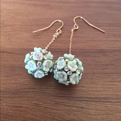 """NWOT Floral Dangle Earrings Floral Dangle Earrings: a sparkly ball pendant made of small mint and mauve flowers with encrusted faux diamonds, dangling from a delicate gold chain.  Never worn. 2"""" long. Jewelry Earrings"""