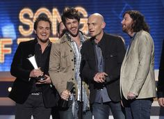 """The Eli Young band accept the award for song of the year for """"Crazy Girl"""" at the 47th annual Academy of Country Music Awards in Las Vegas, Nevada, April 1, 2012."""