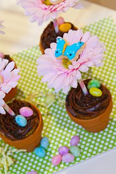 DIY potted cupcakes: Make these by taking miniature terracotta flower pots lined with foil, pop in a cupcake, frost, sprinkle with crushed oreos, insert decorative paper straw, top with faux floral and mini decorated sugar cookies.  So simple the kids could participate too.