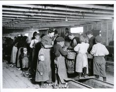 Child labor in Maryland oyster cannery from the series, American Child Labour c.1900-1937, by Lewis Wickes Hines